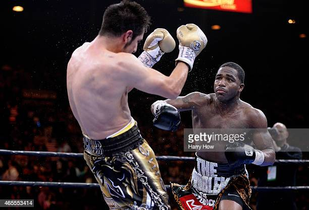Adrien Broner punches John Molina Jr during a Premier Boxing Champions bout in the MGM Grand Garden Arena on March 7 2015 in Las Vegas Nevada