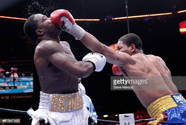 Adrien Broner takes a punch from Shawn Porter during their welterweight fight at MGM Grand Garden Arena on June 20 2015 in Las Vegas Nevada Porter...