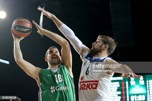 Adrien Moerman of Darussafaka Dogus in action against Andres Nocioni of Real Madrid during the Turkish Airlines Euroleague basketball match between...