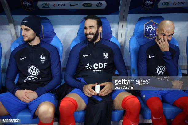 Adrien Rabiot Adil Rami Christophe Jallet of France sit on the bench during the the FIFA 2018 World Cup Qualifier between France and Belarus at Stade...