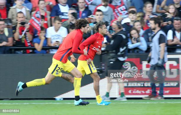 Adrien Rabiot and Neymar Jr of PSG warm up before the French Ligue 1 match between En Avant Guingamp and Paris Saint Germain at Stade de Roudourou on...