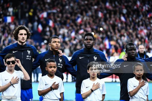 Adrien Rabiot Kylian Mbappe Samuel Umtiti and Ngolo Kante of France during the friendly match France and Spain at Stade de France on March 28 2017 in...