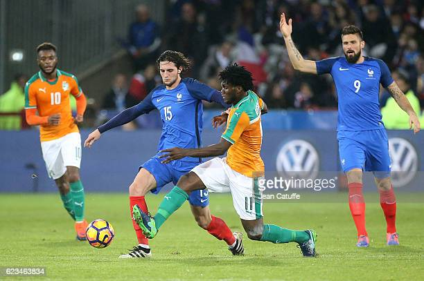 Adrien Rabiot of France and Franck Kessie of Ivory Coast in action during the international friendly match between France and Ivory Coast at Stade...