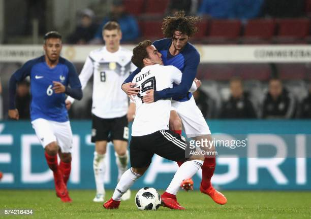 Adrien Rabiot of France and Mario Gotze of Germany battle for possession during the international friendly match between Germany and France at...
