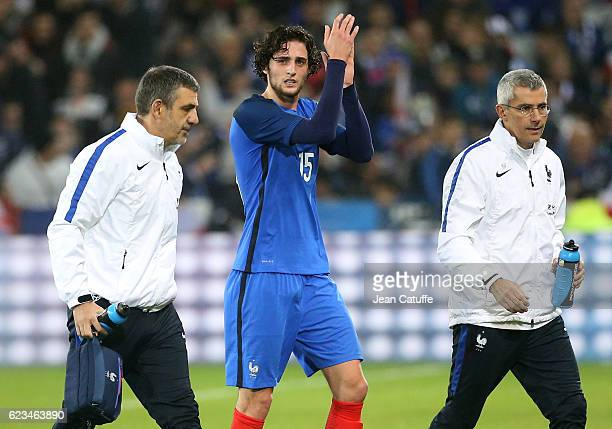 Adrien Rabiot of France leaves the pitch with an injury during the international friendly match between France and Ivory Coast at Stade Felix...