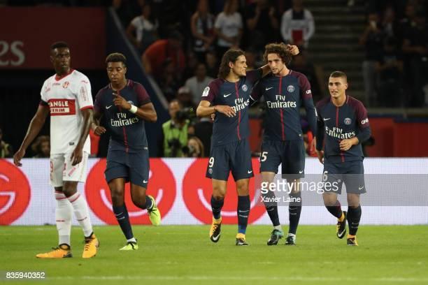 Adrien Rabiot of Paris SaintGermain celebrate his goal with Edinson Cavani during the French Ligue 1 match between Paris Saint Germain and Toulouse...
