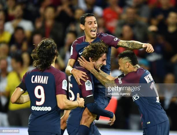 Adrien Rabiot of Paris SaintGermain celebrates with his teammates Neymar Angel Di Maria and Edinson Cavani during the French Ligue 1 soccer match...