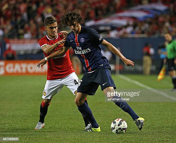 Adrien Rabiot of Paris SaintGermain holds off Andreas Pereira of Manchester United during a match in the 2015 International Champions Cup at Soldier...