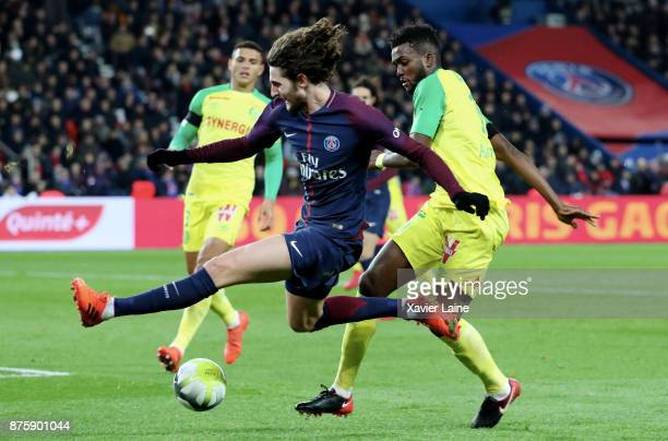 Adrien Rabiot of Paris SaintGermain in action with Chidozie Awaziem of FC Nantes during the Ligue 1 match between Paris SaintGermain and FC Nantes at...
