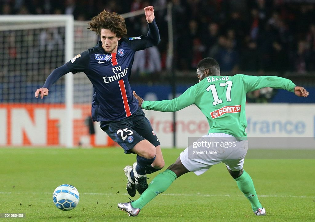 Adrien Rabiot of Paris Saint-Germain in action with Jonathan Bamba of AS Saint Etiennne during the French League Cup between Paris Saint-Germain and AS Saint Etienne at Parc Des Princes on december 16, 2015 in Paris, France.
