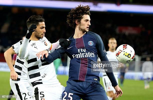 Adrien Rabiot of Paris SaintGermain in action with Selmane Bensebaini of Stade Rennes during the French Ligue 1 match between Paris SaintGermain and...