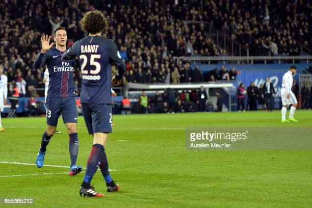 Adrien Rabiot of Paris SaintGermain is congratulated by Julian Draxler after scoring during the French Ligue 1 match between Paris Saint Germain and...