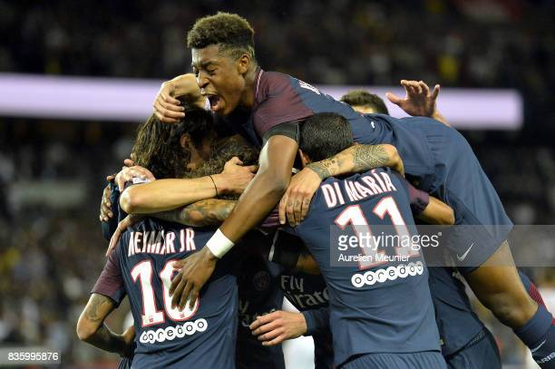 Adrien Rabiot of Paris SaintGermain is congratulated by teammates Neymar Jr Angel Di Maria and Presnel Kimpembe after scoring during the Ligue 1...
