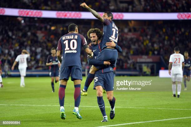 Adrien Rabiot of Paris SaintGermain is congratulated by teammates Neymar Jr and Angel Di Maria after scoring during the Ligue 1 match between Paris...