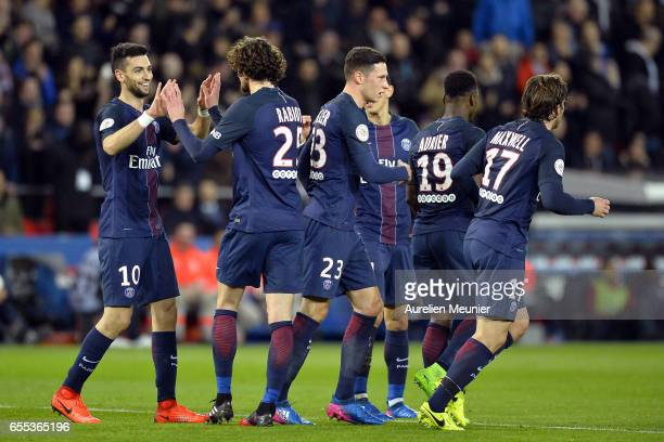 Adrien Rabiot of Paris SaintGermain is congratulated by teammates after scoring during the French Ligue 1 match between Paris Saint Germain and Lyon...
