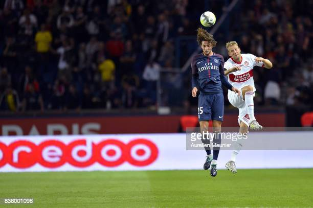 Adrien Rabiot of Paris SaintGermain jumps for the ball during the Ligue 1 match between Paris SaintGermain and Toulouse at Parc des Princes on August...