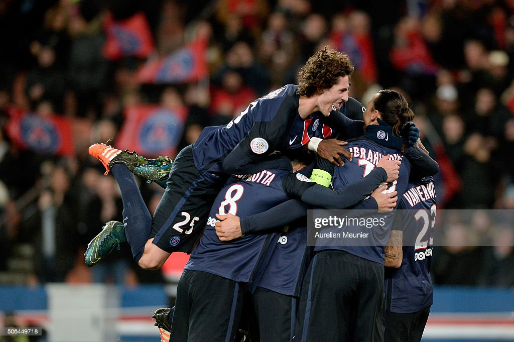 Adrien Rabiot of Paris Saint-Germain jumps on his teammates to celebrate the goal of Gregory Van Der Wiel during the Ligue 1 game between Paris Saint-Germain and Angers SCO at Parc des Princes on January 23, 2016 in Paris, France.