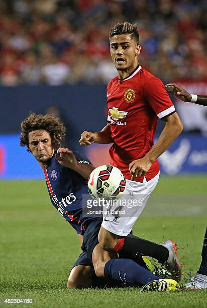 Adrien Rabiot of Paris SaintGermain knocks the ball away from Andreas Pereira of Manchester United during a match in the 2015 International Champions...