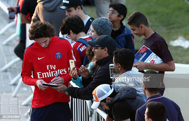 Adrien Rabiot of Paris SaintGermain meets fans during a practice session ahead of a friendly match against Inter Milan pictured on December 28 2015...