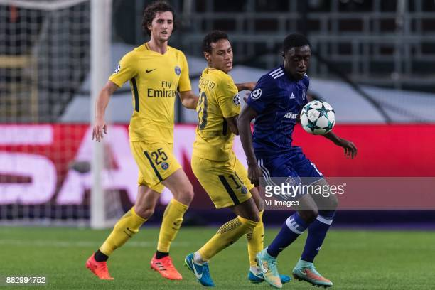 Adrien Rabiot of Paris SaintGermain Neymar da Silva Santos Junior of Paris SaintGermain Dennis Appiah of RSC Anderlecht during the UEFA Champions...