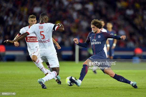 Adrien Rabiot of Paris SaintGermain runs with the ball during the Ligue 1 match between Paris SaintGermain and Toulouse at Parc des Princes on August...