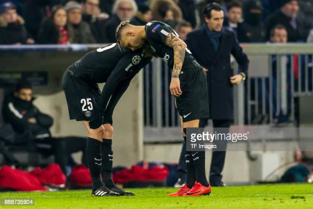 Adrien Rabiot of Paris SaintGermain speaks with Layvin Kurzawa of Paris SaintGermain during the UEFA Champions League group B match between Bayern...