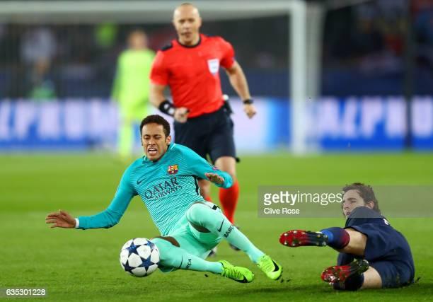 Adrien Rabiot of Paris SaintGermain tackles Neymar of Barcelona during the UEFA Champions League Round of 16 first leg match between Paris...