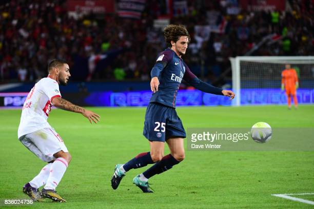 Adrien Rabiot of PSG and Andy Delort of Toulouse during the Ligue 1 match between Paris Saint Germain and Toulouse at Parc des Princes on August 20...