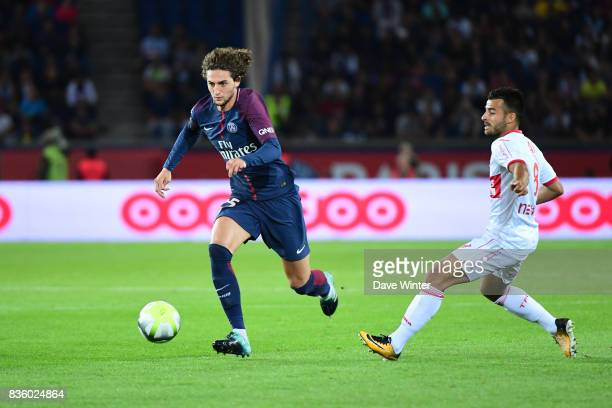 Adrien Rabiot of PSG and Corentin Jean of Toulouse during the Ligue 1 match between Paris Saint Germain and Toulouse at Parc des Princes on August 20...