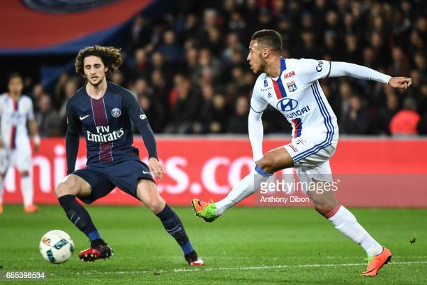 Adrien Rabiot of PSG and Corentin TOlisso of Lyon during the French Ligue 1 match between Paris Saint Germain and Lyon at Parc des Princes on March...