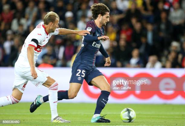 Adrien Rabiot of PSG and Ola Toivonen of Toulouse during the French Ligue 1 match between Paris Saint Germain and Toulouse FC at Parc des Princes on...