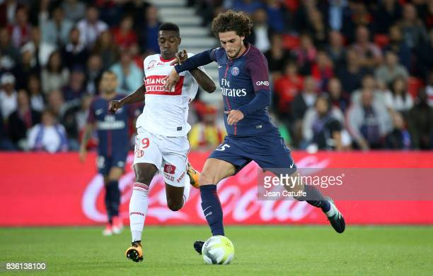 Adrien Rabiot of PSG and Wergiton Somalia of Toulouse during the French Ligue 1 match between Paris Saint Germain and Toulouse FC at Parc des Princes...