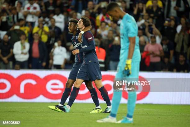 Adrien Rabiot of PSG celebrates his goal with Presnel Kimpembe while goalkeeper of Toulouse Alban Lafont looks down during the French Ligue 1 match...