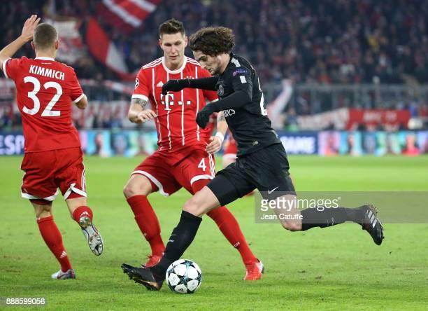 Adrien Rabiot of PSG Niklas Sule of Bayern Munich during the UEFA Champions League group B match between Bayern Muenchen and Paris SaintGermain at...