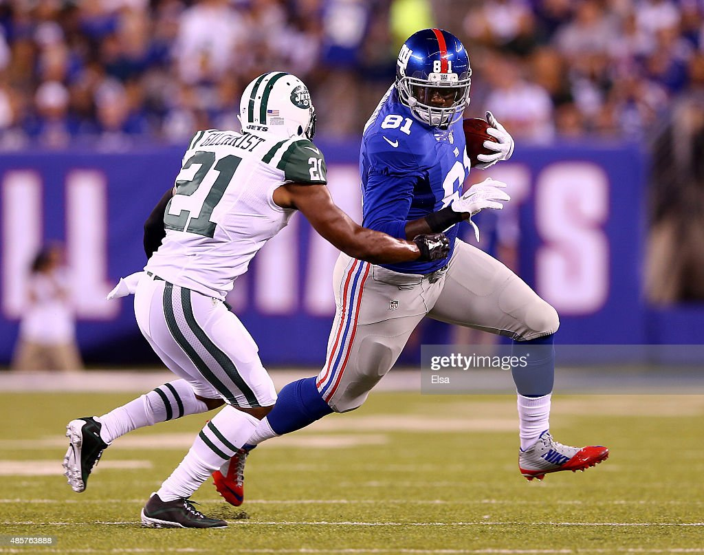 Adrien Robinson #81 of the New York Giants carries the ball as Marcus Gilchrist #21 of the New York Jets defends in the first half during preseason action at MetLife Stadium on August 29, 2015 in East Rutherford, New Jersey.