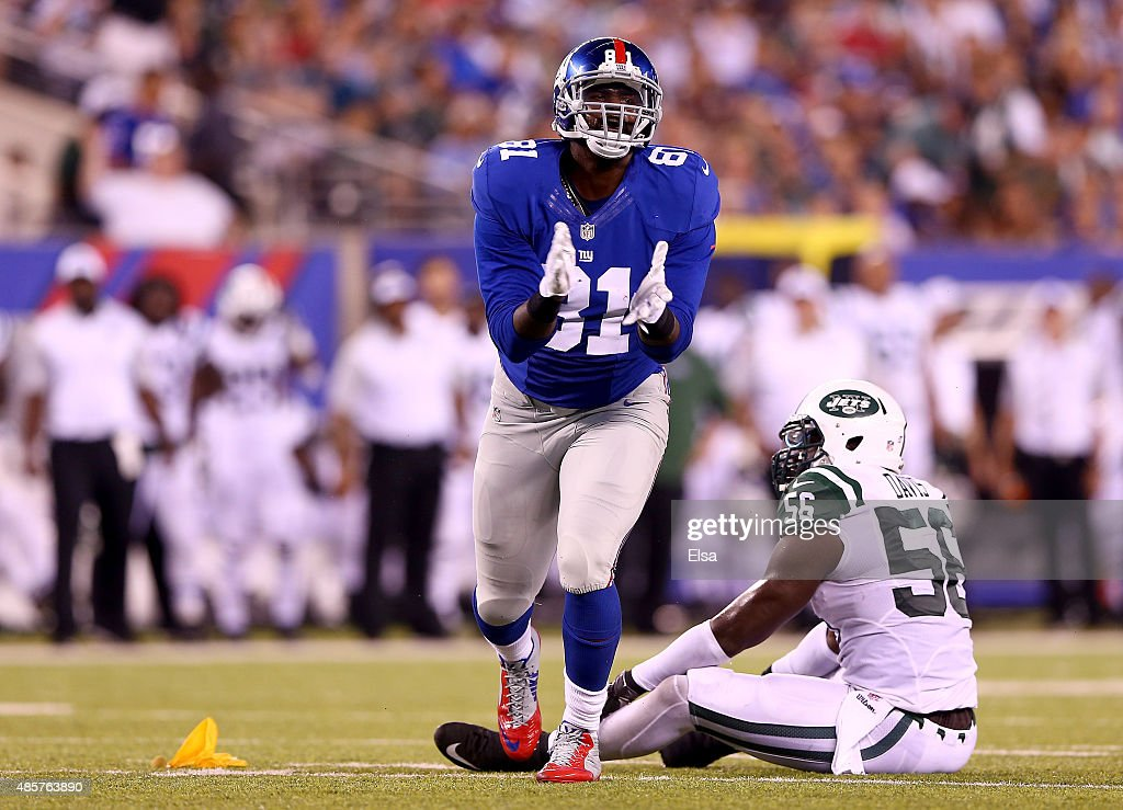 Adrien Robinson #81 of the New York Giants celebrates as Demario Davis #56 of the New York Jets is called for pass interference in the first half during preseason action at MetLife Stadium on August 29, 2015 in East Rutherford, New Jersey.