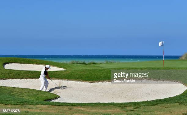 Adrien Saddier of France plays from a bunker on the 3rd hole during day three of The Rocco Forte Open at Verdura Golf and Spa Resort on May 20 2017...
