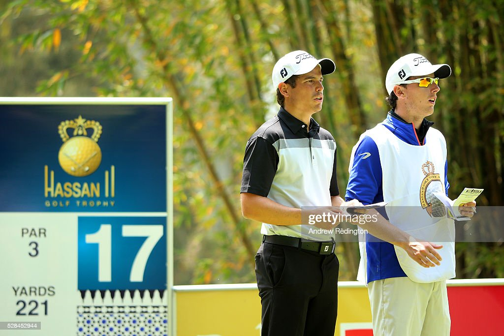 Adrien Saddier of France speaks with his caddie before hitting his tee shot on the 17th during the first round of the Trophee Hassan II at Royal Golf Dar Es Salam on May 5, 2016 in Rabat, Morocco.