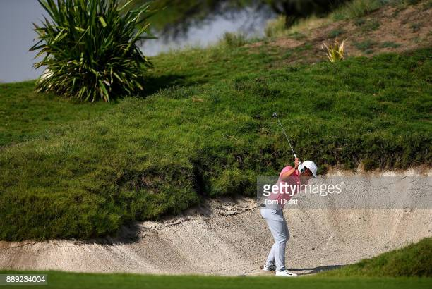 Adrien Saddier of France takes a shot out the bunker on the 1st hole on Day Two of the NBO Golf Classic Grand Final European Challenge Tour at Al...
