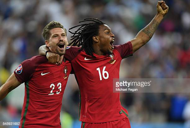 Adrien Silva and Renato Sanches of Portugal celebrate winning at the final whistle during the UEFA EURO 2016 Final match between Portugal and France...
