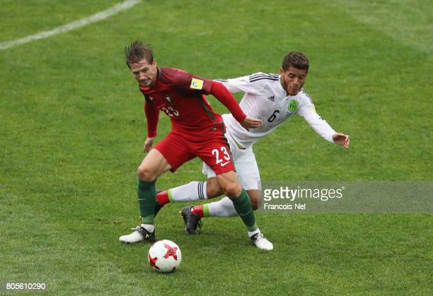 Adrien Silva of Portugal and Jonathan Dos Santos of Mexico battle for possession during the FIFA Confederations Cup Russia 2017 PlayOff for Third...