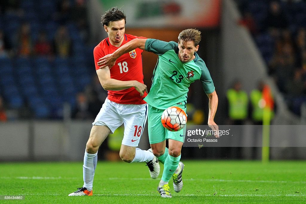 Adrien Silva of Portugal challenges Ole Selnaes of Norway during the International Friendly match between Portugal and Norway at Dragao Stadium on May 29, 2016 in Porto, Portugal.