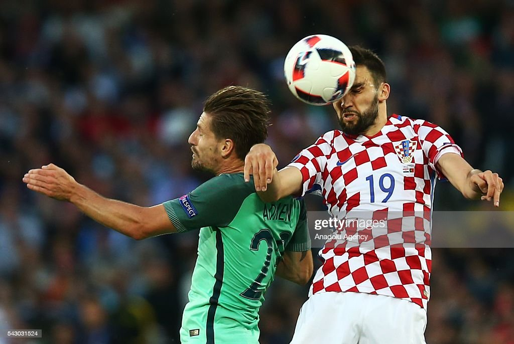 Adrien Silva (L) of Portugal in action against Milan Badelj (R) of Croatia during the Euro 2016 round of 16 football match between Croatia and Portugal at Stade Bollaert-Delelis in Lens, France on June 25, 2016.