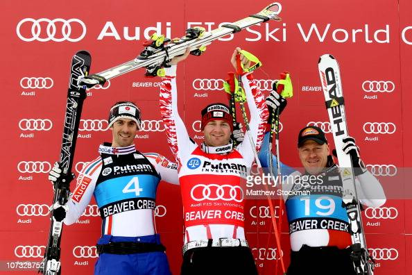 Adrien Theaux of France Georg Streitberger of Austria and Didier Cuche of Switzerland pose for photographers on the medals podium after winning the...