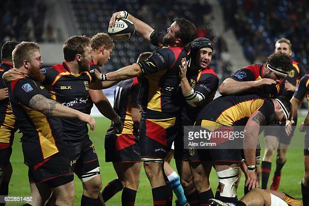 Adrien Theisinger of Germany celebrates with team mates after scoring during an international match between Germany and Uruguay at Frankfurter...