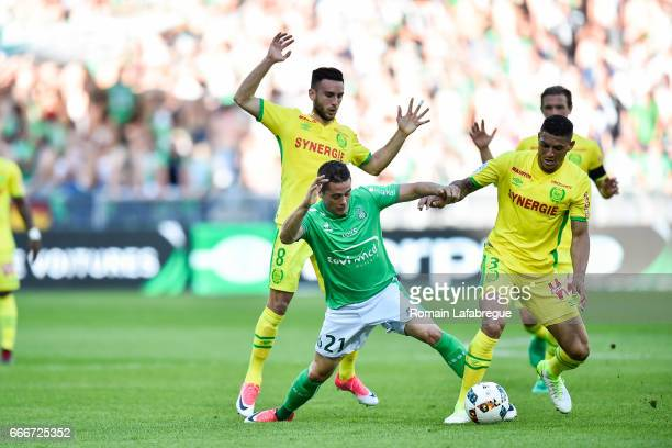 Adrien Thomasson of Nantes Romain Hamouma of Saint Etienne Diego Carlos Santos Silva of Nantes during the Ligue 1 match between As Saint Etienne and...