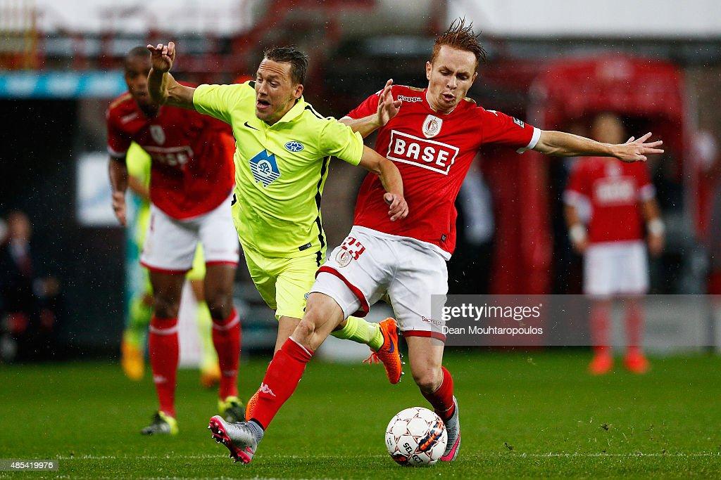 Adrien Trebel of Standard Liege tackles Mattias Mostrom of Molde FK during the UEFA Europa League play off round second leg match between Standard...
