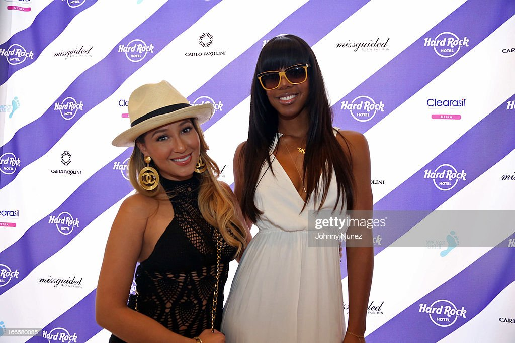 <a gi-track='captionPersonalityLinkClicked' href=/galleries/search?phrase=Adrienne+Bailon&family=editorial&specificpeople=540286 ng-click='$event.stopPropagation()'>Adrienne Bailon</a> and featured host <a gi-track='captionPersonalityLinkClicked' href=/galleries/search?phrase=Kelly+Rowland&family=editorial&specificpeople=201760 ng-click='$event.stopPropagation()'>Kelly Rowland</a> attend the Women Who Rock event at day 2 of the Hard Rock Music Lounge at Hard Rock Hotel Palm Springs, on April 13, 2013, in Palm Springs, California.