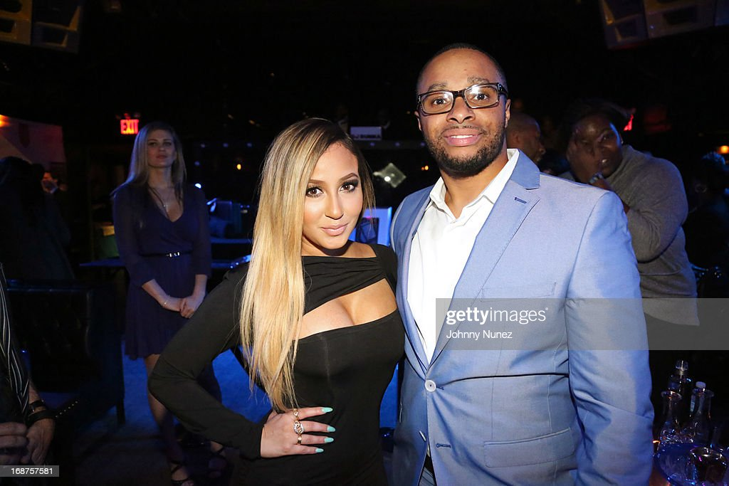 <a gi-track='captionPersonalityLinkClicked' href=/galleries/search?phrase=Adrienne+Bailon&family=editorial&specificpeople=540286 ng-click='$event.stopPropagation()'>Adrienne Bailon</a> and Grady Spivey attend the Bronx Charter School for the Arts 2013 art auction at Marquee on May 14, 2013 in New York City.