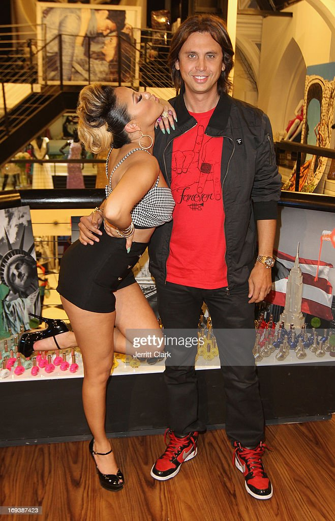 <a gi-track='captionPersonalityLinkClicked' href=/galleries/search?phrase=Adrienne+Bailon&family=editorial&specificpeople=540286 ng-click='$event.stopPropagation()'>Adrienne Bailon</a> and <a gi-track='captionPersonalityLinkClicked' href=/galleries/search?phrase=Jonathan+Cheban&family=editorial&specificpeople=538047 ng-click='$event.stopPropagation()'>Jonathan Cheban</a> attend the Launch of her Fingertip Fetish Nail Polish at Modalistas on May 23, 2013 in New York City.